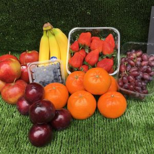 shows fresh fruit on a green background